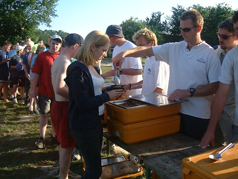Serving dinner on a school camp