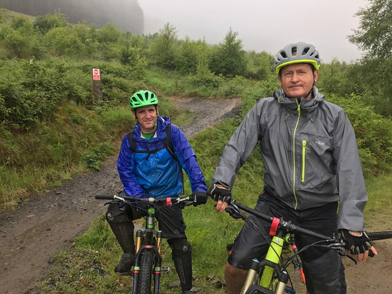 Steve and Kev biking in the wet at Bike Park Wales