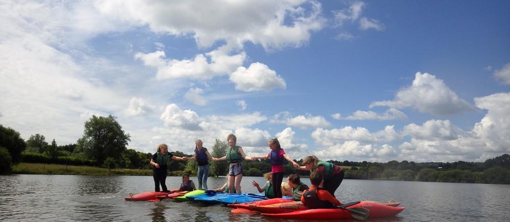 Fun in kayaks on a school residential in Sussex