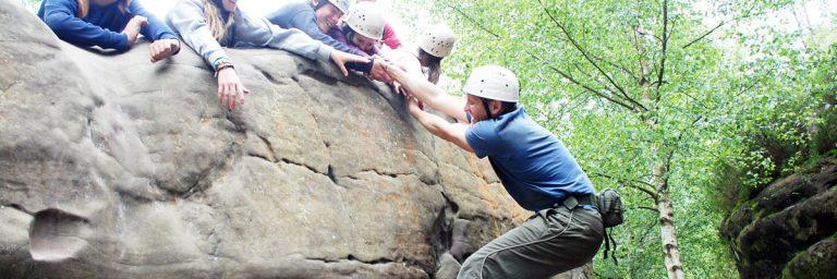 Rock scrambling at camp