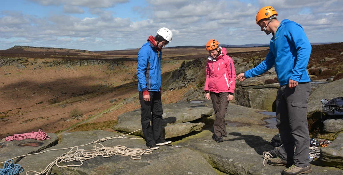 Training to set up climbs in the Peak District - trainee outdoor instructors at TrekCo